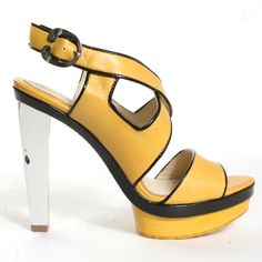 Travel the world like a gypsy in this stalking sandal from L.A.M.B. A yellow leather upper is accented with a black patent trim with criss cross straps leading to an adjustable heel strap closure with a 1/2 inch platform and a silver 4 1/2 inch heel that is embossed with the signature L.A.M.B. insignia.