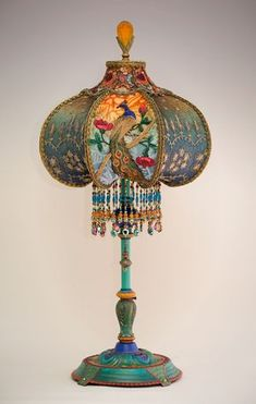 Peacock & Roses silk and beaded shade. The shade is ombré dyed in jewel tones of raspberry and amber into green and blue tones and has alternating panels of dyed burnout velvet and styled antique net lace with feather motifs. Victorian Lamps, Antique Lamps, Vintage Lamps, Victorian Lighting, Victorian Art, Funky Lamps, Funky Lamp Shades, Bohemian Lamp, Porcelain Dolls For Sale