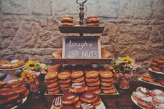 We want doughnuts in leiu of a wedding cake (we will also have a cake but it will be very small, just for us and wedding party) and we want a stand like this with the chalkboard sign as well!