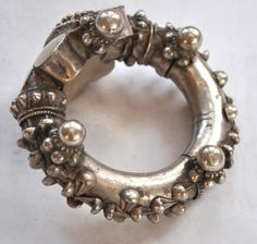 Hinge opening bracelet with large decorated wrist portion. This style is from either Rajasthan or Gujerat India Early to mid 20th c