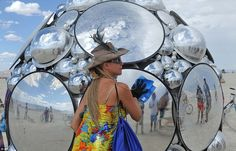Lucy in the sky: Artist Kirsten Berg cleans her artwork, a mirrored sphere that reflects the sky