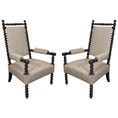 Pair of 19th Century Ebonized Bobbin Chairs with Arms