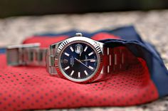 Rolex Oyster Perpetual watch on a pocket square.