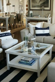 Navy and white. Very nautical beachy, white glass top coffee table