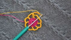 Chain 6 (ch-6 loops made). Remove the hook from the loop and insert it in dc of previous round (as at the photo). Yarn over yellow loop and pull it through.