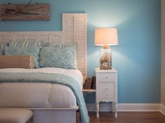 Such a pretty bedroom with Beachcomber details! - Fillable lamp and driftwood art sculpture