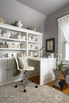 Incorporate the pull down desk feature in custom bookcases along window wall!