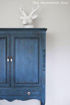 A deep blue milk paint cabinet