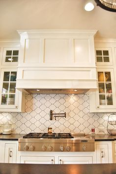 I definitely need a pot filler in my next kitchen! Lots of Fits and Kisses: Outdated Ranch home meets Southern & Simple Update. Kitchen Hood Design, Kitchen Vent Hood, Kitchen Stove, New Kitchen Cabinets, Kitchen Cabinet Colors, Kitchen Redo, Kitchen Backsplash, Kitchen Remodel, Kitchen Ideas