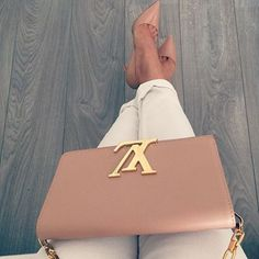 Chic Louis Vuitton cross-body paired with classic Christian Louboutin's