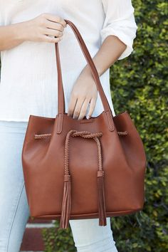 Slouchy bucket tote with braided drawstring pull & suede tassels | Sole Society Costello