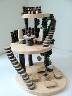 Wooden fairy tree house by LightofdayCreations on Etsy.