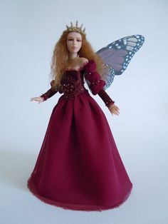 Doll with Monarch butterfly wings