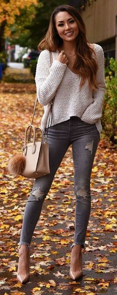 Jessica R. + cute and cosy + gorgeous cream knit sweater + distressed jeans + heels + ideal fall look + minimal accessories + Jessica + stripped back style. Sweater/Jeans: Express.