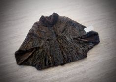 ^^^ Free international shipping ^^^ A brand new handmade short Swakara astrakhan fur cape. It comes in brown or black color. It is lined with inner lining and has inner hooks and loops to keep it closed. It has also been processed through a professional cleaning process after its
