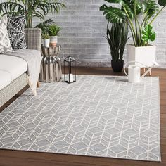 Add style to your indoor or outdoor space with the Jaipur Living Galloway Rug. Made of a durable polypropylene and polyester blend, this contemporary design features an on-trend chevron pattern in sophisticated, light hues of gray and cream. Indoor Outdoor Area Rugs, Outdoor Areas, Outdoor Living, Grey And Beige, Gray, Chevron Area Rugs, Living Room Area Rugs, Living Rooms, Area Rug Sizes