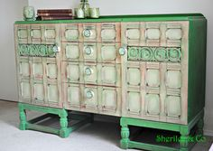 Gorgeous Sideboard hand painted in Annie Sloan Antibes Green and Emperors Silk red & Versailles layered on the doors for texture and floral green knobs to complimenr and complete this unique vintage piece