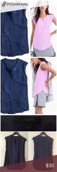 J.Crew sleeveless drapy popover shirt. Size: 00. J.Crew sleeveless drapy popover shirt. Size: 00. Chest: 17 inches. Length: 25 inches. Navy blue (pink top shown for modeling purposes). Slightly longer in the back. The prettiest top that's the best of both worlds, thanks to our silk-like fabric that drapes beautifully and is easy to care for. Just pop it in the wash and do a quick iron instead of making a trip to the dry cleaners. Poly. Machine wash. Great preowned condition. (Stock photos…
