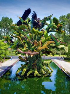 The Mosaïcultures exhibit brings together horticulture artists from around the world to create living and growing sculptures at Montreal's Botanical Garden. 2013