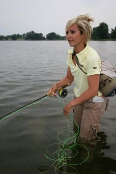 Beautiful woman and a fly rod - a divine combination