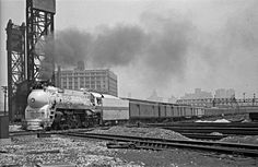 https://flic.kr/p/EwgxZ6 | ATSF, Chicago, Illinois, 1946 | Santa Fe passenger train no. 23, the westbound Grand Canyon led by streamlined 4-6-4 steam locomotive no. 3460, crossing the Pennsylvania and the Chicago & Western Indiana railroads at 21st Street on its way out of Chicago on June 22, 1946. Photograph by Wallace W. Abbey, © 2015, Center for Railroad Photography and Art. Abbey-01-052-02