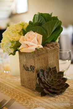 Burlap #WeddingCenterpiece featuring Succulents, Roses and Hydrangeas I La Boutique Nostalgie