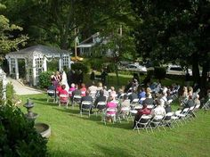 Intimate wedding ceremony at Fuquay Mineral Spring Inn and Garden in Fuquay-Varina, North Carolina