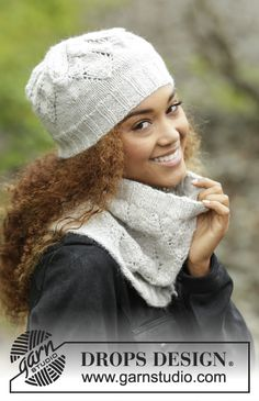 Set consists of: Knitted DROPS neck warmer and hat with lace pattern in Karisma or Puna.