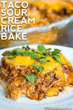 Taco Sour Cream Rice Bake A tasty and comforting bake that's done in thirty minutes. Beef Casserole, Casserole Recipes, Meat Recipes, Mexican Food Recipes, Cooking Recipes, Dinner Recipes, Recipies, Recipes With Rice, Burrito Casserole