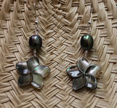 Carved Mother of Pearl Plumeria earrings by fortheloveofplumeria, $20.00