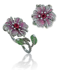 Ring, interchangeable single or double-finger design, flowerhead mounted with an oval-shaped ruby centre to the brilliant-cut diamond stamen and pistons, with pavé-set pink sapphire and diamond petals and double leaf detail, Anna Hu