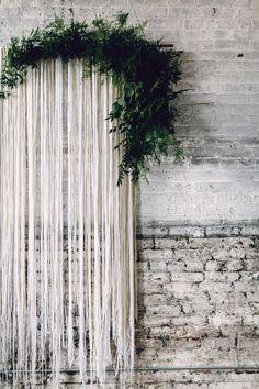 streamer backdrop with greenery - photo by Danfredo Photos Film http://ruffledblog.com/nordic-industrial-wedding-inspiration