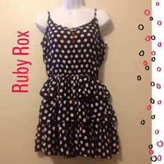 Ruby Rox Short black and ivory Polk a dot dress 5 Red buttons down the front, adjustable straps, red thread belt loops but No belt. Ruffled bottom. In great condition Ruby Rox Dresses