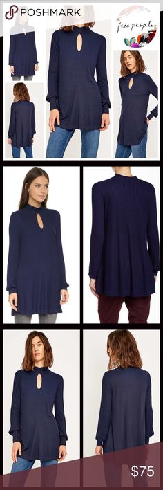 """FREE PEOPLE RIBBED TUNIC Swing Top 💟NEW WITH TAGS💟Retail: $88  FREE PEOPLE RIBBED TUNIC Swing Top  * Oversized body/relaxed loose knit A-line cape silhouette  * Incredibly soft & flowy fabric  * Mock neck, long sleeves, side slits, & front keyhole detail  * Approx 31"""" long  * Pullover/stretch-to-fit  Fabric:96% Rayon, 4% Spandex Color: Navy Item#FP T-Shirt copa banana  🚫No Trades🚫 ✅Offers Considered*/Bundle Discounts✅ *Please use the blue 'offer' button to submit an offer. Free People…"""
