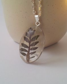 Real leaves Necklace, Oval Faceted crystal resin pendant, Eco-Friendly, Stainless steel Chain, clear resin