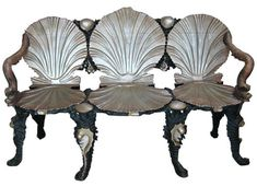 Image above: Wood-carved silver-painted grotto settee, 1920s, $8000