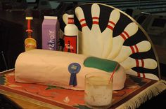 Big Lebowski cake - like the bowling pin decorations in the background to use as decoration at the party.