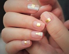 Contrast a strip of white polish with a little rectangle of gold foil and you'll have the graphic trend down to a tee.