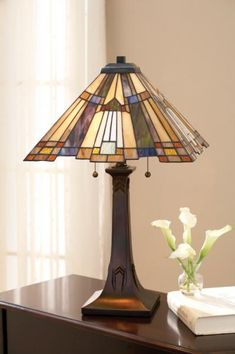 Inglenook Table Lamp  This Arts and Crafts style lamp from Quoizel features a pyramid shade with a stepped border for added visual interest....