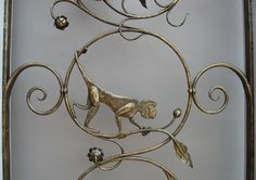 Grille detail with monkey