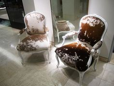 Cow hide chairs, for the head of the dining room table with another chair design for the side chairs.
