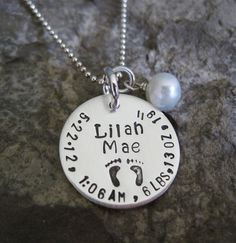 "Personalized Sterling Silver Birth Announcement Necklace- includes 3/4"" Inch Hand Stamped Circle charm , a pearl or crystal, and ball chain. $30.25, via Etsy."