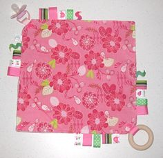 Our Taggy Comforter Blankets are a must have for little kids. As well as a heap of glorious tags to twiddle, two opposite corners have tabs can hold a dummy, teething ring, or toy. The third corner has a gorgeous crinkly sound, and the last corner folds with a click to secure to the buggy or carseat. Available in Girls, Boys and Unisex designs. Only NZ$28.00 from http://squoodles.co.nz