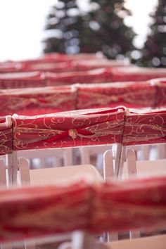 Like the idea of the tops of chairs decorated like this...