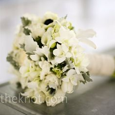 White Wedding Bouquet    A small assortment of French anemones, lush garden roses, dendrobium orchids, japhet orchids, and accents of seasonal foliage combined rustic simplicity with modern elements.