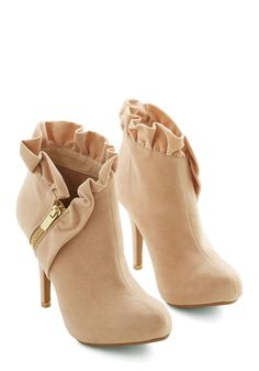Ruffled booties with zippers http://rstyle.me/n/pcujsn2bn