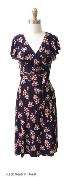The Daisy Wrap Dress is an American-made dress, featuring a v-neck and is great dress for hourglass shaped gals! This knee length dress is Black Neutral Floral is a great way to transition your wardrobe to Fall.