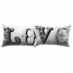I don't think I can justify paying $40 for these {LOVE} pillowcases...but it's very tempting.