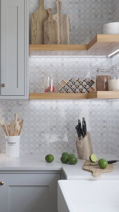 Add a modern geometric backsplash to your kitchen with the Thassos Square And Carrara Octagon Marble Mosaic Tile along with open shelving and gray cabinets to keep the look bright and airy Grey Kitchen Cabinets, Decor, Backsplash For White Cabinets, Modern Kitchen Backsplash, Kitchen Backsplash Designs, Kitchen Wall, Kitchen Tiles Backsplash, Home Decor, White Kitchen Backsplash