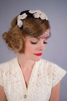 Example of a half hat with a pretty veil (make sure veils don't cover face too much though), one style that was really popular in the 1950s!